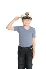 Boy in the sea cap salutes. His cap emblem of Russia.
