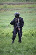 Special force soldier in black tactical suit