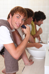 Boys shaving and brushing their teeth
