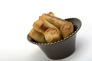 Egg rolls in a ceramic bowl