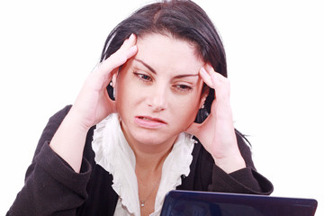 woman in the office at the workplace suffers headaches.