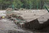 Destroyed Chainlink Fence after Flood Disaster poster