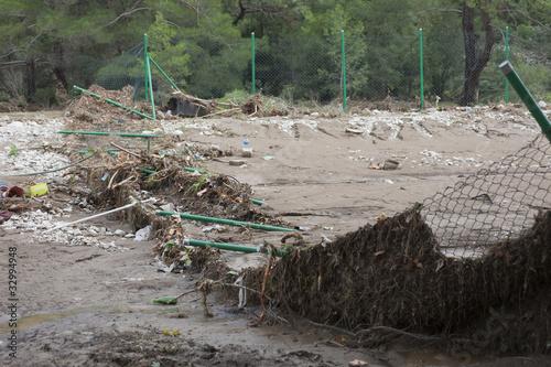 Destroyed Chainlink Fence after Flood Disaster