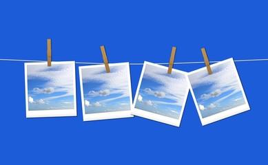 Cielo appeso con mollette su fondo azzurro