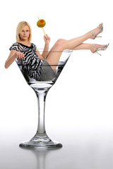 Young Blond Woman in a martini glass