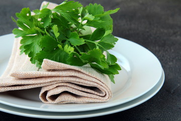 plates with a linen napkin and a sprig of parsley