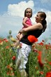 family walking in poppy field