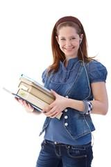 Happy schoolgirl with books