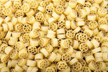 Raw Wagon wheel pasta noodles closeup macro