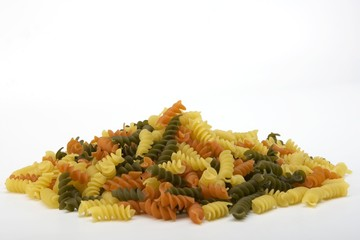Colorful raw spiral pasta noodles in a pile