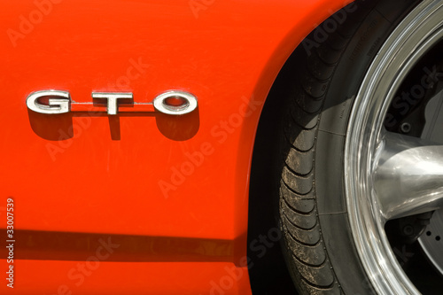 GTO badge and sports car wheel arch