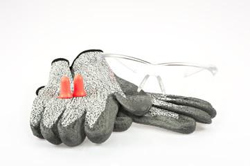Arbeitshandschuhe, Gehörschutz und Sicherheitsbrille