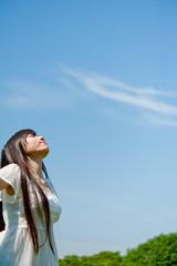 beautiful asian woman looking sky