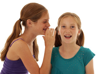 happy tween girls telling secrets