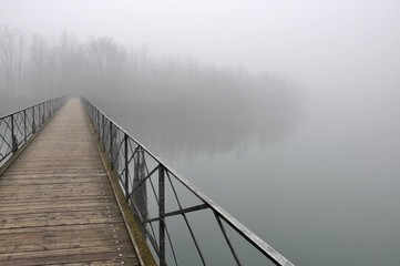 pedestiran bridge in fog, adda river