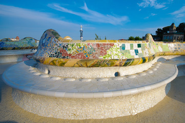 Famous long mosaic bench in Park Guell in Barcelona