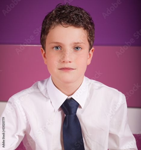 Young adolescent dressed in business clothes