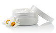 Cosmetic face cream container with chamomile