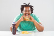 happy overweight african american man eating a hamburger