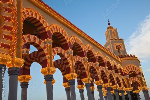 Leinwanddruck Bild Iluminación de la portada de la feria de Córdoba