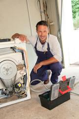 Plumber fixing washing machine