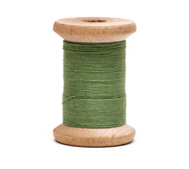 Thread bobbin on white background