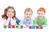 Three happy children with kids blocks