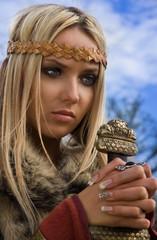 Viking girl on a blue sky background