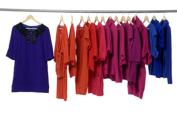 colored fashion cloth hanging on hangers