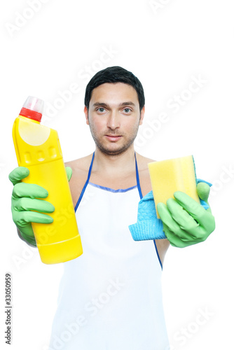 man in apron holding cleaning sponge and bottle on white