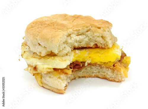 Bitten bacon egg cheese breakfast sandwich