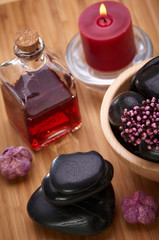spa, black hot stones and essential oil