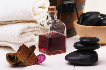 balanced stones, essential oil and towel