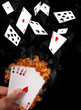 Poker cards with burning triumph in hand