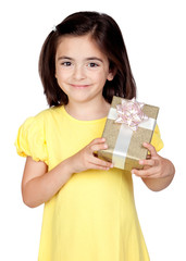 Brunette little girl with a gift