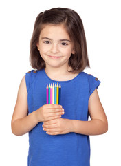 Brunette little girl with colored pencil