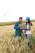 farmer and engineer wind in wheat fields