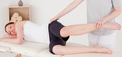 Sportswoman having a leg stretching