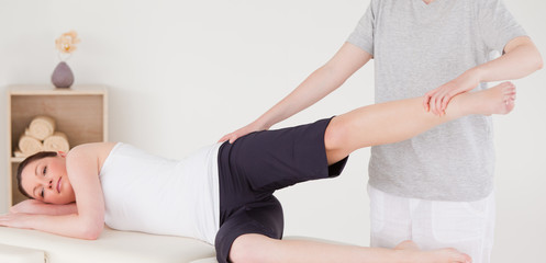 Sportswoman having a leg and hips stretching