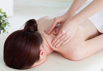 Young woman having a rolling massage
