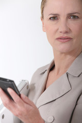 Female executive with cellphone