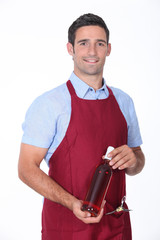 Waiter holding bottle of wine