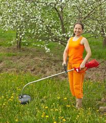 woman gardener  cut grass