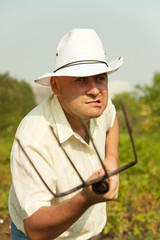 angry farmer holding pitchfork