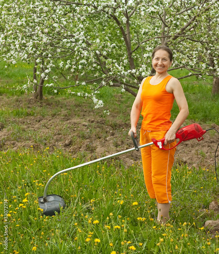woman gardener  cut grass
