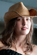 Beautiful woman with cowboy hat