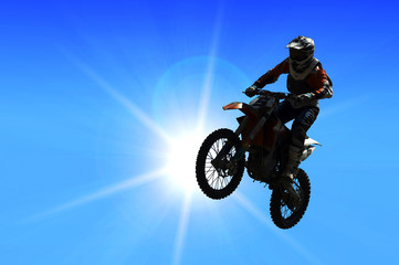 motorcycle jumping from a high rock