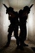 Silhouette of soldiers with guns