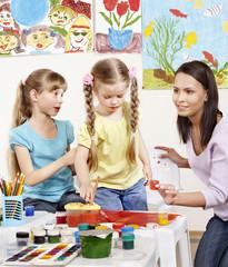 Kids painting in preschool.