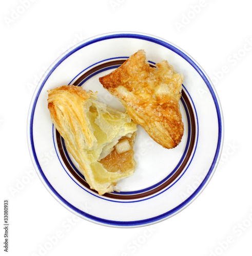 Broken apple turnover portion on plate